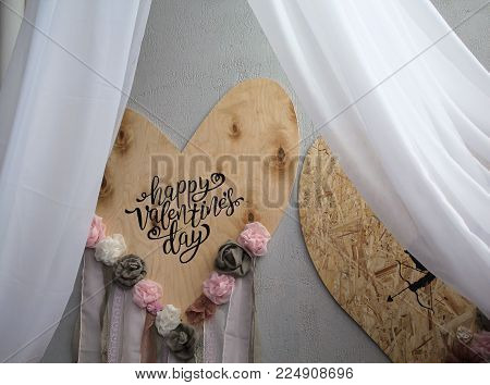 Decor for Valentine's Day, two hearts on wooden background closed canopy