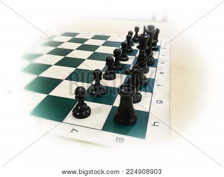 Closeup of chess pieces on board before a match