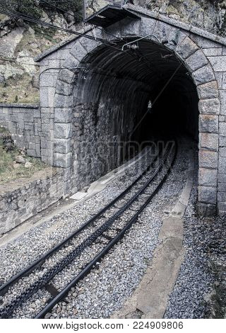 Old tunnel train of The Vall de Nuria Rack Railway. It is a mountain railway in the Pyrenees exit in Vall de Nuria