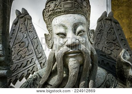 Chinese style sculpture and thai art architecture in Wat Phra Chetupon Vimolmangklararm (Wat Pho) temple in Thailand.