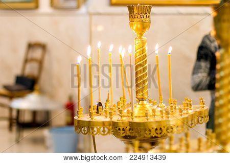 Set of candles in the church concept of religion