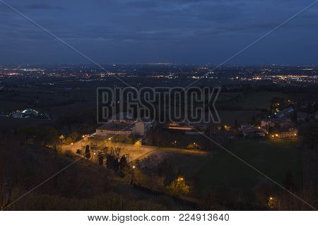 Small italian town called Bertinoro, surrounded by vineyards, meadows, zone of production of traditional italian red wine Sangiovese, by night