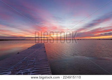 A Colorful Colorado Sunrise at Lon Hagler reservoir in Loveland Colorado located in Larimer County