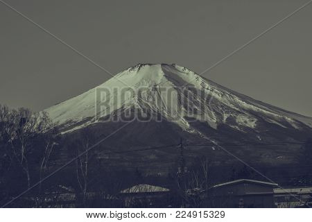 Black and White image of Beautiful landscape view of Fuji mountain or Mt.Fuji covered with white snow in winter seasonal at Yamanaka Lake, Japan.