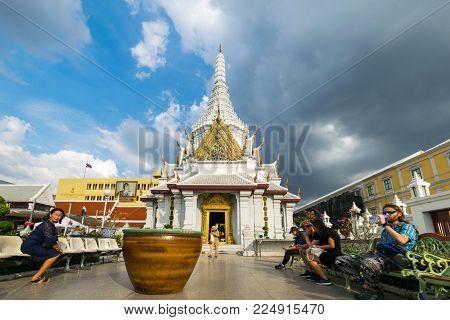 Bangkok, Thailand - Nov. 29, 2017 :  Unidentified People Sit In Bangkok City Pillar Shrine Area  (or