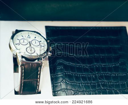 Gift set for men watch and purse closeup photo