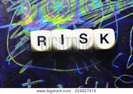 word risk on an   abstract colored background