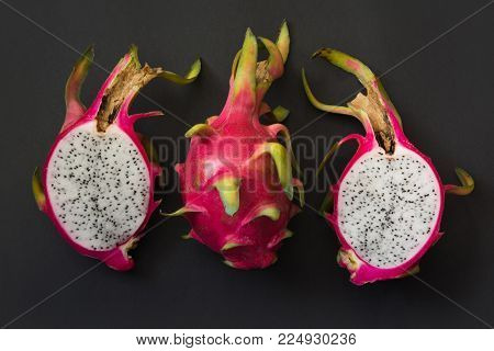 Isolated tropical pitaya, dragon fruit on blackbackground. Close up. top view.