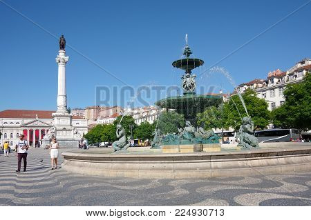LISBON, PORTUGAL - OCTOBER 14, 2015: Rossio Square is the popular name of the Pedro IV Square in Lisbon, Portugal. It has been one of its main squares since the Middle Ages