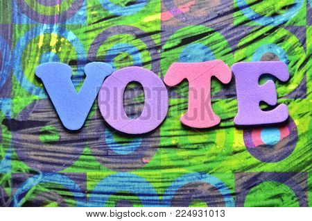 word vote on an abstract colored background