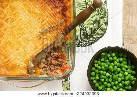 Shepherd's pie or cottage pie is a meat pie with a topping of mashed potato. Selective focus.