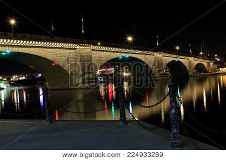 Night shot of the London Bridge located in Lake Havasu City, Arizona. Bridge was purchased in England where it was disassembled and moved to Arizona where it was put back together across the channel of Lake Havasu.