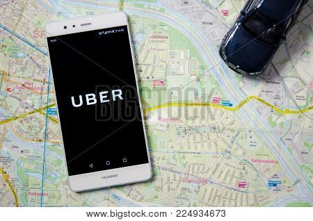 WROCLAW, POLAND - DEC 13,2017 : Uber logo on Huawei P9. Uber is sharing-economy service for ubran transport.