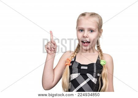 Little beautiful girl with something thought up and raised her finger up isolated on white background