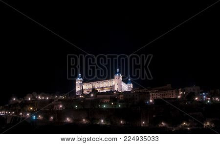 Alcazar of Toledo night view, Spain. The Historic City of Toledo was declared a World Heritage Site by UNESCO in 1986