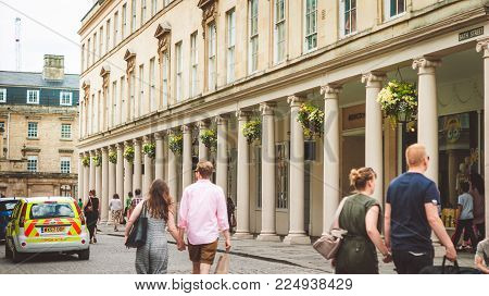 Bath,UK-July 4, 2015: View of the exterior of the Roman Baths and the Abbey square taken in Bath, Somerset, UK