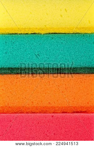Sponge texture background. polymeric material with a foam structure. Close up color washing pad. Abrasive sponge texture background.