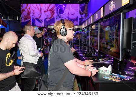 Cologne, Germany - August 24, 2017: Trade fair visitors playing the game dragonball fighter z at Gamescom 2017. Gamescom is a trade fair for video games held annually in Cologne.