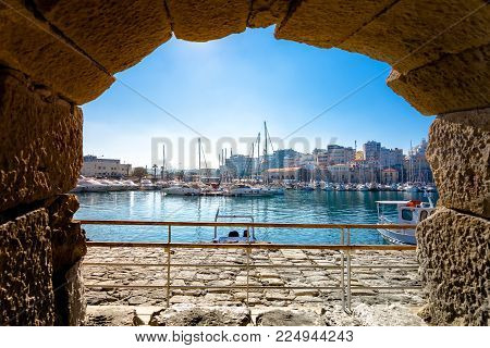 Heraklion Harbour With Old Venetian Fort Koule And Shipyards, Crete, Greece