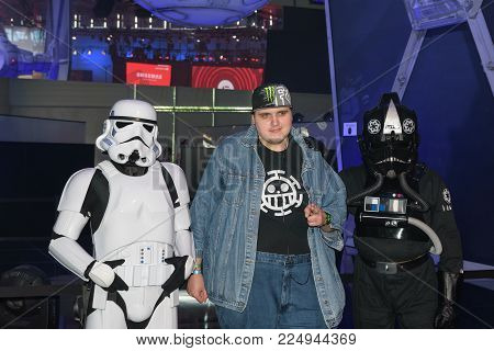 Cologne, Germany - August 24, 2017: A gamer posing with two star wars actors for the game star wars battlefront II of the company EA at Gamescom 2017. Gamescom is a trade fair for video games held annually in Cologne.