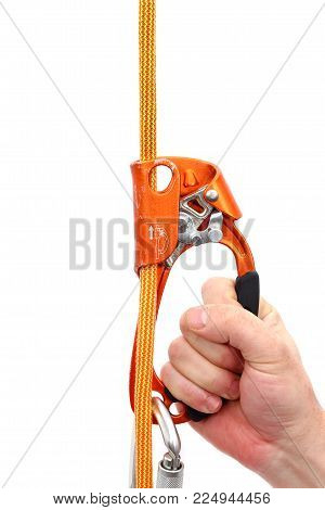 Man hand holding a climbing quick ascender on a rope