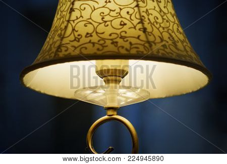 lampshade on a dark background. lamp yellow