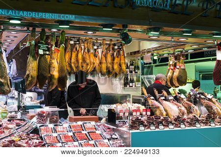 BARCELONA, SPAIN - 11 JANUARY 2018: The old grocery market of Barcelona Boqueria selling food jamon vegetables for tourists and visitors to the city.