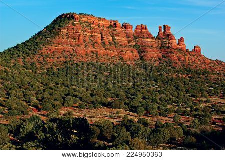 A view of the Cockscomb Mountain near sundown. Located in Sedona Arizona, this view is from the Aerie Trail on the westside.