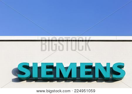 Tilst, Denmark - February 14, 2016: Siemens logo on a facade. Siemens is a german multinational. The principal divisions of the company are industry, energy, healthcare, infrastructure and cities