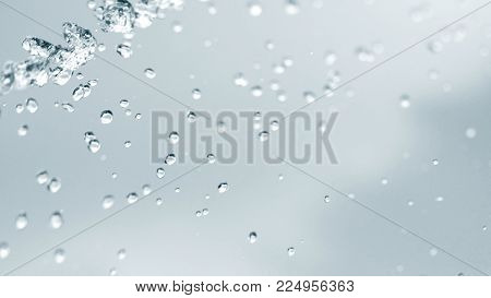 Water particles as background / Water is a transparent and nearly colorless chemical substance that is the main constituent of Earth's streams, lakes, and oceans, and the fluids of most living organisms.