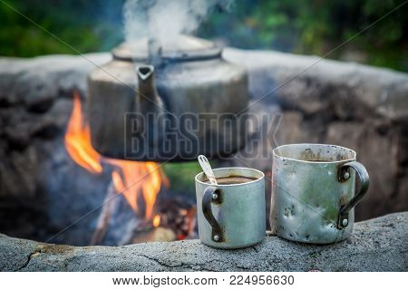 Aromatic And Hot Coffee With Kettle On Bonfire