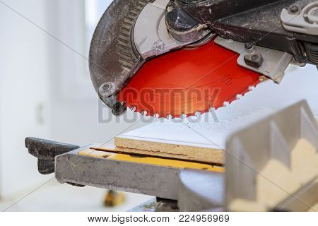 Wooden plank on a circular saw Electro saw for cutting wooden shelves