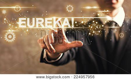 Eureka text with businessman on dark vintage background