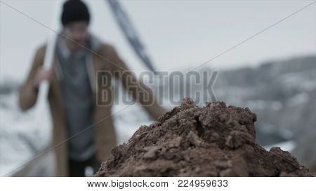 Man With The Flag On Top Of The Mountain Inserts A Flag In The Ground, Bottom View Close Up. Footage