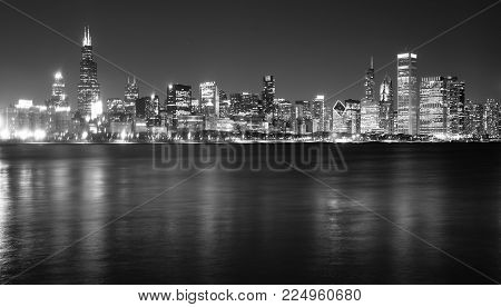 Waters Of Lake Michigan Reflect The Light Of Tall Buildings Comprising The Chicago City Skyline