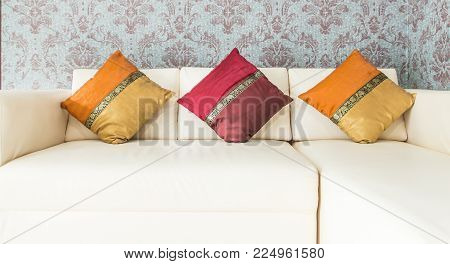 Red And Yellow Color Of Three Cushions On White Sofa In Livingroom