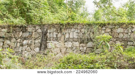 stone wall inside hill for protection water down to house