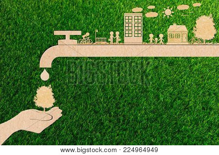 ecology concept of paper human hands holding big plant tree No pollution Water and forest Clean energy water save