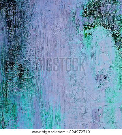 Green, Pink and Blue Damaged Obsolete Cement Wall Background closeup
