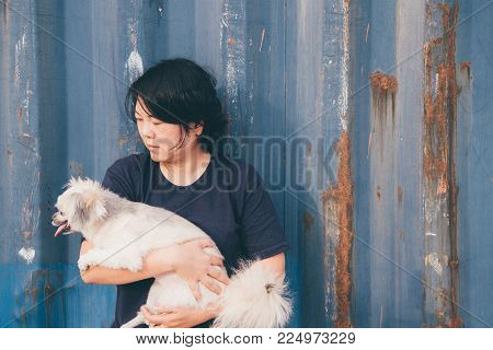 Asian Woman And Dog Happy Smile Hugging Her Pat Is A Dog So Cute Mixed Breed With Shih-tzu, Pomerani