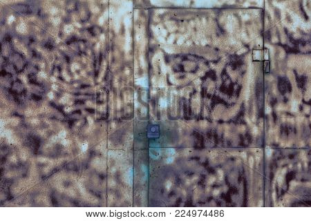 Old rusty locked metal gate. staining with unusual stains