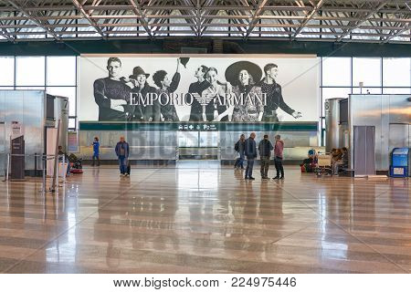 MILAN MALPENSA, ITALY - CIRCA NOVEMBER, 2017: Emporio Armani ad at Milan-Malpensa Airport, Terminal 1.