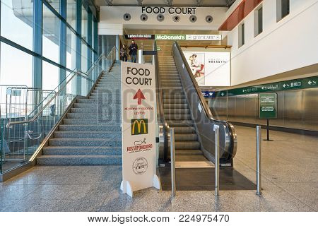 MILAN MALPENSA, ITALY - CIRCA NOVEMBER, 2017: McDonald's restaurant and food court sign at Milan-Malpensa airport.