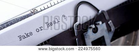Text Fake or Real written on an old typewriter