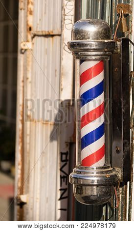Vertical compostion rotating barber pole red white blue cut hair
