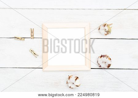 Wooden Frame With Wooden Clothespins And Cotton Flowers. Mock Up