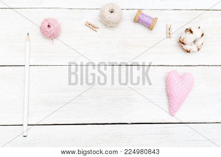 Objects for creativity on a white wooden background. Sewing copy space