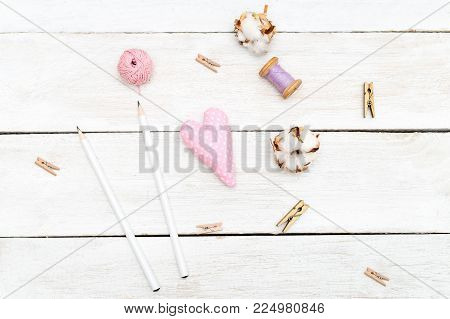 Objects for creativity on a white wooden background. Sewing flat lay