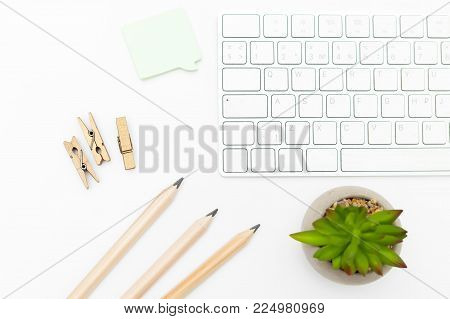 Keyboard and pencils on a white background. Scandinavian style