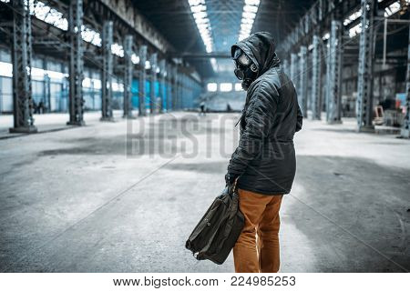 Stalker soldier in gas mask, horror of nuclear war